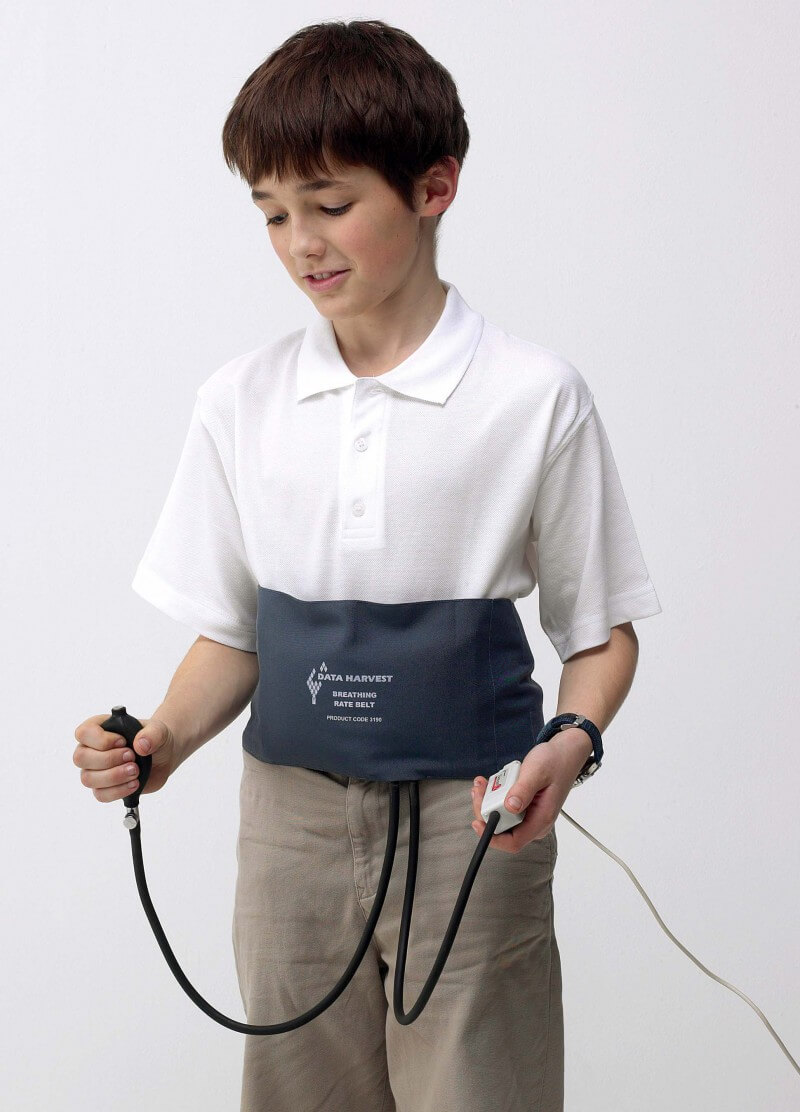 Boy with breathing rate sensor